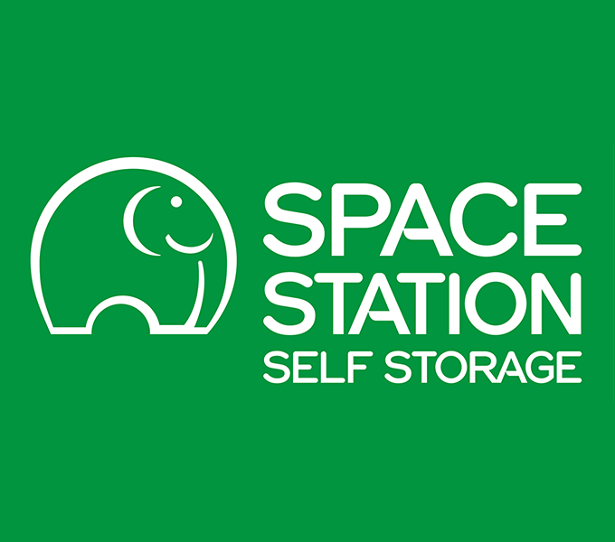 Space Station Self Storage logo on corporate green background