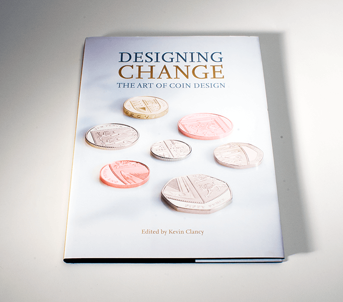 Jacket for Designing Change: the art of coin design casebound book