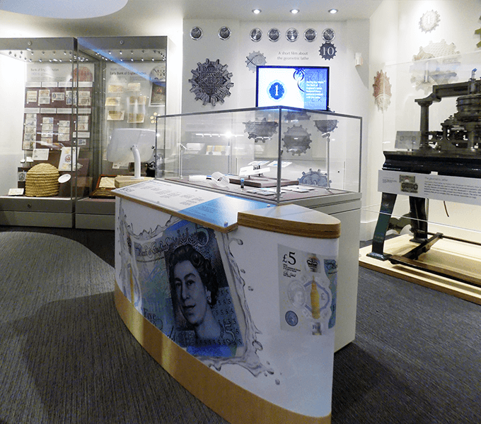 Display on the new polymer £5 note with geometric lathe in the background
